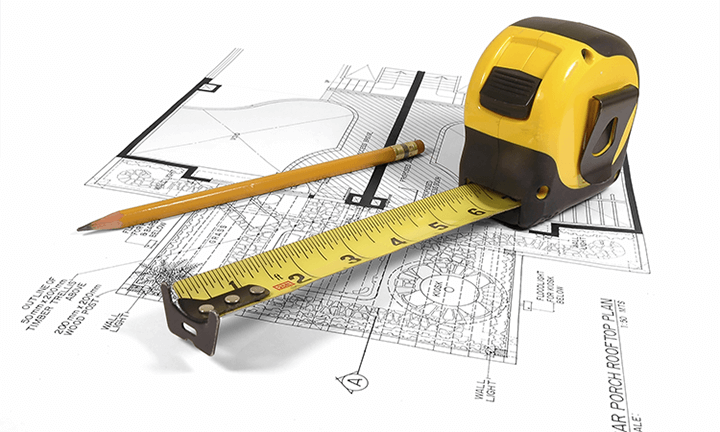 Huisplan met potlood en rolmaat