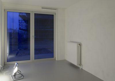 Gestucte muren met betonlook vloer van egaline